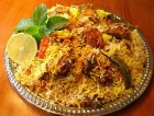 making of chicken dhum biryani